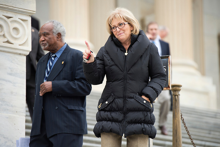 UNITED STATES - DECEMBER 04: Reps. Diane Black, R-Tenn., and Danny Davis, D-Ill., walk down the House Steps after the last votes of the week in the Capitol, December 4, 2014. (Photo By Tom Williams/CQ Roll Call)