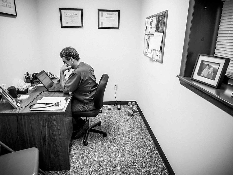 Physician Assistant Arthur Cerami works in his office at the E.A. Hawse Medical Center in Mathias, West Virginia.