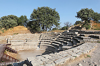 Roman Odeon, built during the reign of Emperor Augustus, 63 BC - 14 AD, in Troia IX,  in the ruins of the Homeric city of Troy, Hill of Hissarlik, Turkey. The Odeon was used for musical performances. It has a semi-circular orchestra, with a skein or stage building and several tiers of seats constructed of large limestone blocks and divided by aisles into wedge-shaped sections.  Troy was a city, both factual and legendary, in northwest Anatolia and was the setting of the Trojan Wars described in Homer's Iliad. Picture by Manuel Cohen