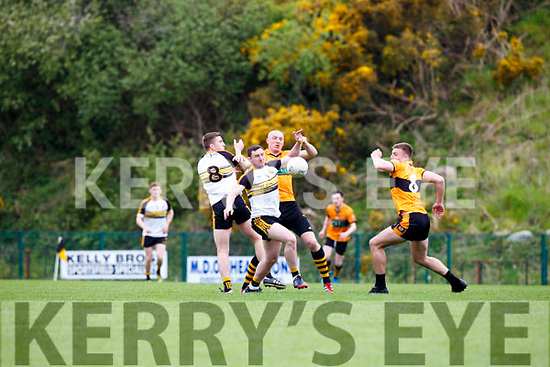 Dr Crokes Daithi Casey and Michael Milner challenge Kieran Donaghy to the dropping ball during their Club Championship clash in Killarney on Sunday