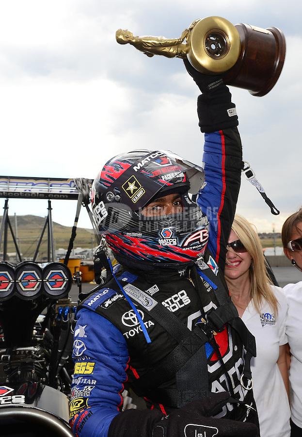 Jul, 22, 2012; Morrison, CO, USA: NHRA top fuel dragster driver Antron Brown celebrates after winning the Mile High Nationals at Bandimere Speedway. Mandatory Credit: Mark J. Rebilas-US PRESSWIRE