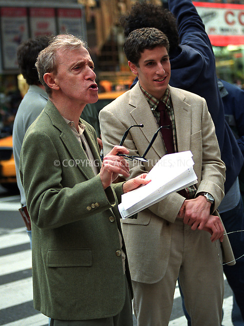 "Director Woody Allen tries to calm down a crowd of fans as they shout ""Woody, Woody when are you back to court?"" while filming ""Anything Else"" with Jason Biggs on Broadway in New York. June 7, 2002. Please byline: Alecsey Boldeskul/NY Photo Press.   ..*PAY-PER-USE*      ....NY Photo Press:  ..phone (646) 267-6913;   ..e-mail: info@nyphotopress.com"
