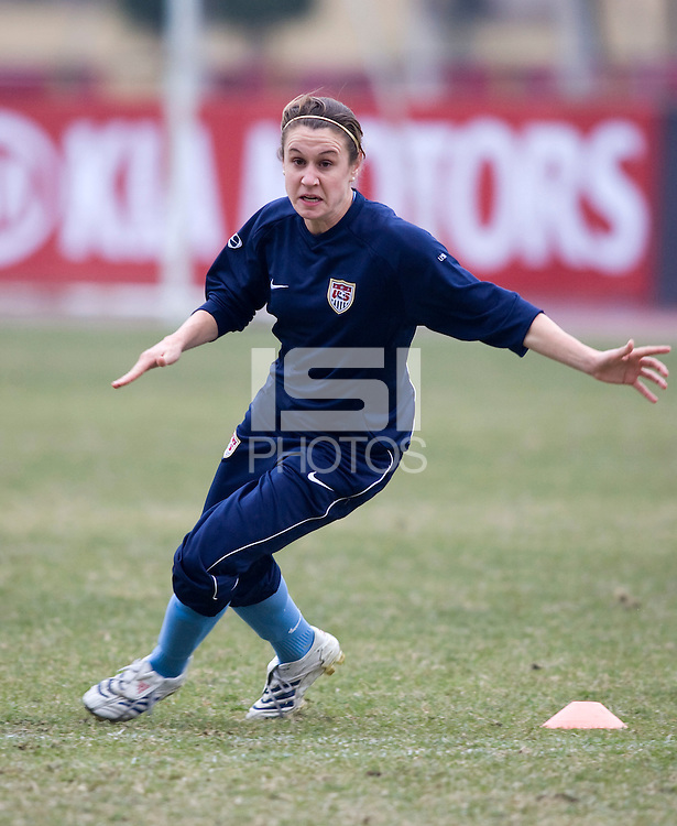 Heather O'Reilly. The USWNT practices during a cold, rainy day while in  Guangzhou, China, for the Four Nations Tournament on January 17, 2008.