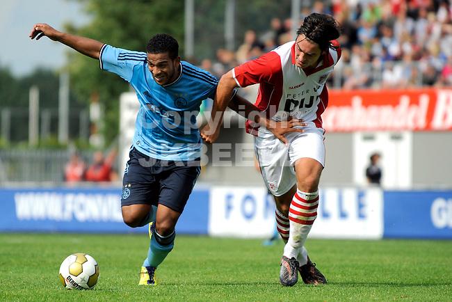 EMMEN - FC Emmen - Ajax voorbereiding  seizoen 2011-2012 , 09-07-2011  Ajax speler Lorenzo Ebecilio (l) met Emmen speler Sander Fischer (r).
