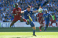 Liverpool's Sadio Mane has a shot at goal while under pressure from Cardiff City's Gary Madine<br /> <br /> Photographer Ian Cook/CameraSport<br /> <br /> The Premier League - Cardiff City v Liverpool - Sunday 21st April 2019 - Cardiff City Stadium - Cardiff<br /> <br /> World Copyright © 2019 CameraSport. All rights reserved. 43 Linden Ave. Countesthorpe. Leicester. England. LE8 5PG - Tel: +44 (0) 116 277 4147 - admin@camerasport.com - www.camerasport.com