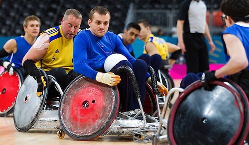 18 APR 2012 - LONDON, GBR - Great Britain's Andy Barrow (GBR) (centre) prepares to pass during the London International Invitational Wheelchair Rugby Tournament match against Sweden at the Olympic Park Basketball Arena in Stratford, London, Great Britain .(PHOTO (C) 2012 NIGEL FARROW)