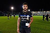 Man of the Match Taulupe Faletau of Bath Rugby poses for a photo with his bottle of champagne. Heineken Champions Cup match, between Bath Rugby and Wasps on January 12, 2019 at the Recreation Ground in Bath, England. Photo by: Patrick Khachfe / Onside Images