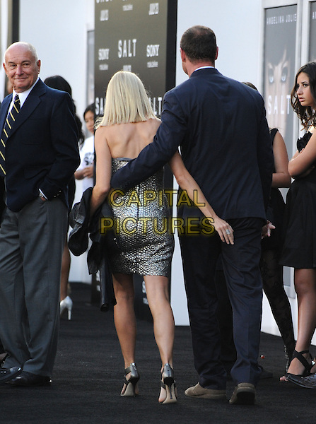 LIEV SCHREIBER & NAOMI WATTS.Premiere of SALT held at The Grauman's Chinese Theatre in Hollywood, California, USA. .July 19th, 2010         .full length strapless silver dress black suit couple back behind rear arms around waist.CAP/RKE/DVS.©DVS/RockinExposures/Capital Pictures.