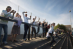 Home supporters celebrating their team's second goal at the Mersey Travel Arena, home to Marine Football Club, as they played host to Ilkeston FC in a Northern Premier League premier division match. The match was won by the home side by 3 goals to 1 and was watched by a crowd of 398. Marine are baed in Crosby, Merseyside and have played at Rossett Park (now the Mersey Travel Arena)  since 1903, the club having been formed in 1894.