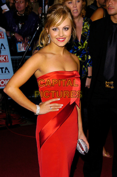 TINA O'BRIEN .The National Television Awards 2006 held at the Royal Albert Hall, London, UK. - Arrivals.October 31st, 2006.Ref: CAN.half length red strapless dress hand on hip .www.capitalpictures.com.sales@capitalpictures.com.©Can Nguyen/Capital Pictures