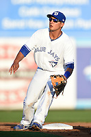 Dunedin Blue Jays  second baseman Christian Lopes (14) waits for a throw during a game against the Brevard County Manatees on April 11, 2014 at Florida Auto Exchange Stadium in Dunedin, Florida.  Brevard County defeated Dunedin 5-2.  (Mike Janes/Four Seam Images)