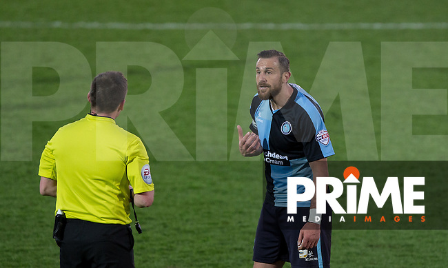 Referee has words with Paul Hayes of Wycombe Wanderers during the Sky Bet League 2 match between Wycombe Wanderers and Yeovil Town at Adams Park, High Wycombe, England on 19 April 2016. Photo by Andy Rowland.