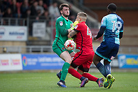 Myles Weston of Wycombe Wanderers nips in to score his goal as Goalkeeper Sam Sargeant and Jens Janse of Leyton Orient have a mix up during the Sky Bet League 2 match between Leyton Orient and Wycombe Wanderers at the Matchroom Stadium, London, England on 1 April 2017. Photo by Andy Rowland.