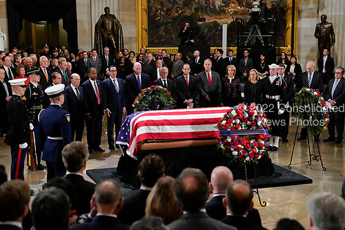 Members of President Donald Trump's cabinet stop to pay their respect infront of the flag-draped casket of former President George H.W. Bush at the Capitol in Washington, Monday, Dec. 3, 2018. (AP Photo/Pablo Martinez Monsivais/Pool)