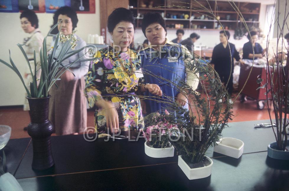 October, 1980. Tokyo, Japan. Women practicing Ichiban Flower Arragement in Ginza district of Tokyo.
