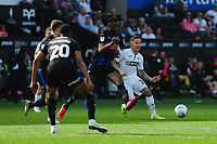 Semi Ajayi of Rotherham United vies for possession with Barrie McKay of Swansea City during the Sky Bet Championship match between Swansea City and Rotherham United at the Liberty Stadium in Swansea, Wales, UK.  Friday 19 April 2019