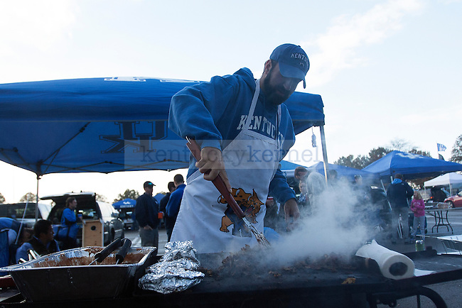 A UK fan cooks prior to the game against Alabama St. in Lexington, Ky., on Saturday, November 2, 2013. Photo by Michael Reaves | Staff