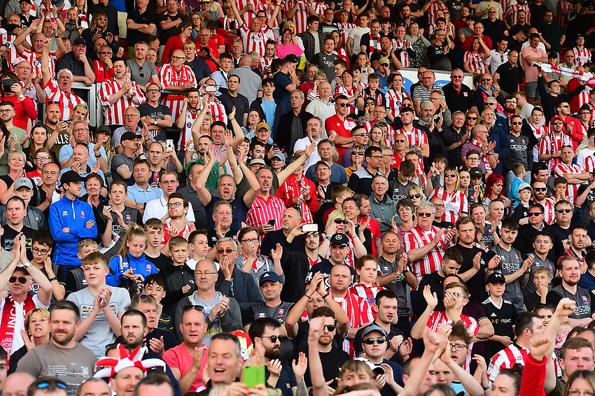 Lincoln City fans celebrate securing the League 2 Title<br /> <br /> Photographer Andrew Vaughan/CameraSport<br /> <br /> The EFL Sky Bet League Two - Lincoln City v Tranmere Rovers - Monday 22nd April 2019 - Sincil Bank - Lincoln<br /> <br /> World Copyright © 2019 CameraSport. All rights reserved. 43 Linden Ave. Countesthorpe. Leicester. England. LE8 5PG - Tel: +44 (0) 116 277 4147 - admin@camerasport.com - www.camerasport.com