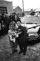 Xian Wang and Wuxi Yue stand in front of their wedding car in the suburb area of Inner Mongolia, China. Since then, they turn to another page in their life. The handsome couple agreed to get married and became engaged last Valentine's day. The dwarf marriage ceremony attracted the attention of the whole of Zhangfang village who came out to wish the couple happiness and prosperity... XIE TSING SONG /SINOPIX