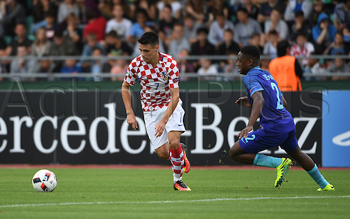 12.07.2016. Donaustadion, Ulm, Germany.  Croatia's Josip Brekalo (l) scores the goal to make it 1:2, next to The Netherlands' Deyovaisio Zeefuik, during the UEFA Under-19 European Championship group B match between Croatia and The Netherlands, at the Donaustadion, in Ulm, Germany, 12 July 2016.