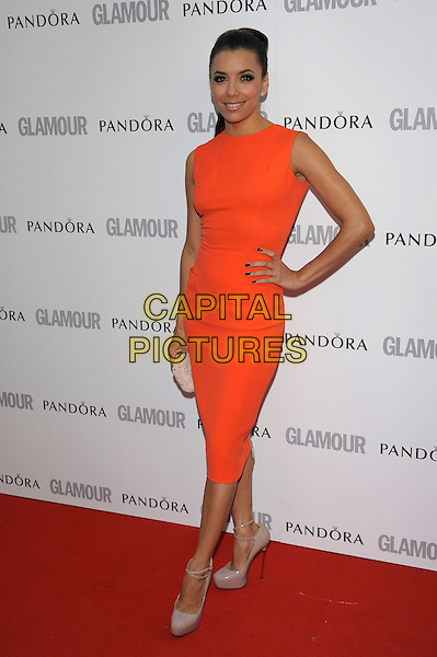 Eva Longoria.Women Of The Year 2012 - Glamour Awards, Berkeley Square, London, England..29th May 2012.full length orange sleeveless dress hand on hip beige shoes .CAP/PL.©Phil Loftus/Capital Pictures.
