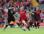 Liverpool's Jordan Henderson tussles with Crystal Palace's Luka Milivojevic during the premier league match at the Anfield Stadium, Liverpool. Picture date 19th August 2017. Picture credit should read: David Klein/Sportimage