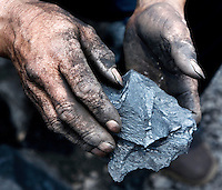 A worker holds a piece of coal at a mine in Shanxi Province.