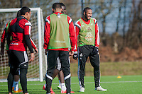 SWANSEA, WALES - FEBRUARY 17:  Ashley Williams of Swansea City  jokes with team mates during a training session at the Fairwood training ground on February 17, 2015 in Swansea, Wales.  (Photo by Athena Pictures )