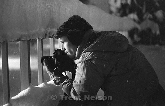 Trent Nelson photographing in a snowstorm. photo by Ted Hansen<br />