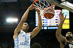 14 February 2016: North Carolina's Brice Johnson (11) dunks the ball over Pittsburgh's Sheldon Jeter (right). The University of North Carolina Tar Heels hosted the University of Pittsburgh Panthers at the Dean E. Smith Center in Chapel Hill, North Carolina in a 2015-16 NCAA Division I Men's Basketball game. UNC won the game 85-64.