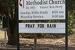 "The  sign outside the Seaton United Methodist Church in the evacuation zone urges passers-by to ""Pray for Rain.""  The hoped for rain failed to fall on the Dyer Mill fire in Grimes County, Texas on June 21, 2011."