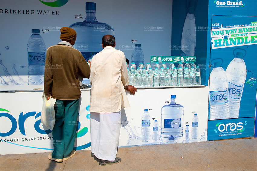 India. Uttar Pradesh state. Allahabad. Maha Kumbh Mela. Two men, both indian customers, stand at the exhibition stand of Oras. Oras, the National Packaged Drinking Water, is a brand owned by Nimbus Beverages Pvt Ltd. The Kumbh Mela, believed to be the largest religious gathering is held every 12 years on the banks of the 'Sangam'- the confluence of the holy rivers Ganga, Yamuna and the mythical Saraswati. The Maha (great) Kumbh Mela, which comes after 12 Purna Kumbh Mela, or 144 years, is always held at Allahabad. Uttar Pradesh (abbreviated U.P.) is a state located in northern India. 9.02.13 © 2013 Didier Ruef