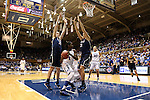 17 December 2013: Duke's Elizabeth Williams (1) is trapped by UConn's Breanna Stewart (30) and Stefanie Dolson (31). The Duke University Blue Devils played the University of Connecticut Huskies at Cameron Indoor Stadium in Durham, North Carolina in a 2013-14 NCAA Division I Women's Basketball game.