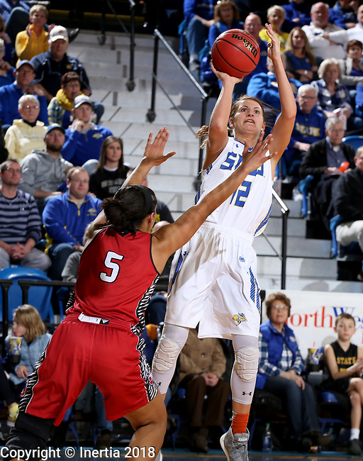 BROOKINGS, SD - JANUARY 25: Macy Miller #12 from South Dakota State University shoots over Jasmine Trimboli #5 from the University of South Dakota during their game Thursday night at Frost Arena in Brookings. (Photo by Dave Eggen/Inertia)