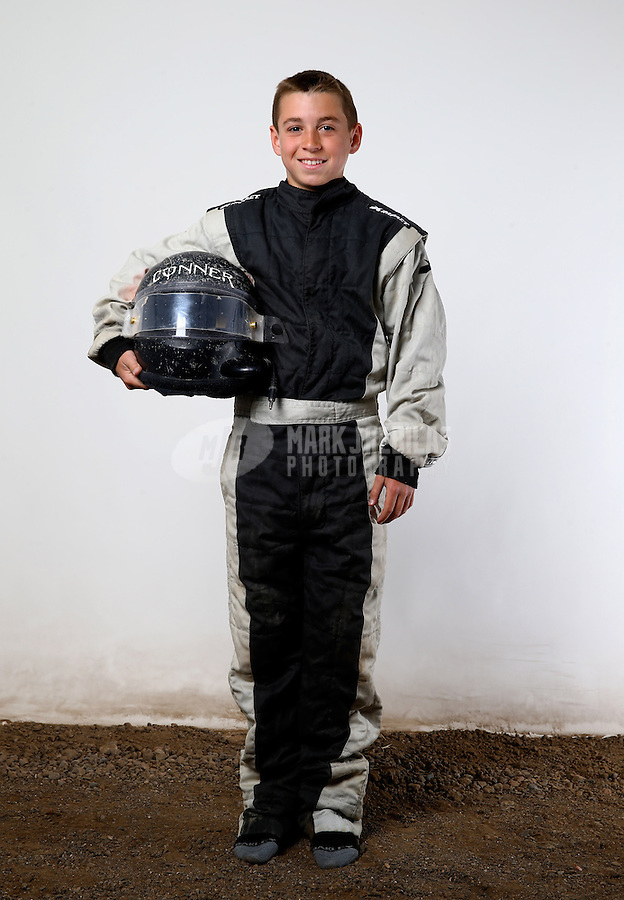 Mar. 21, 2014; Chandler, AZ, USA; LOORRS modified kart driver Conner McMullen poses for a portrait prior to round one at Wild Horse Motorsports Park. Mandatory Credit: Mark J. Rebilas-USA TODAY Sports