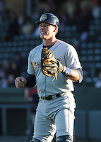 Catcher Peter O'Brien (9) of the Charleston RiverDogs prior to a game against the Greenville Drive on Opening Day, Friday, April 5, 2013, at Fluor Field at the West End in Greenville, South Carolina. (Tom Priddy/Four Seam Images)