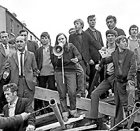 Bernadette Devlin, People's Democracy Movement, addresses supporters from a barricade at William Street, Londonderry, N Ireland, UK, just prior to the arrival of UK Home Secretary, James Callaghan, on a visit to the city following recent civil unrest. August 1969. 196908270024.<br />