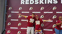 COPY BY TOM BEDFORD MEDIA<br /> Pictured: Matt Evans (R) and a friend at a Redskins match in the US<br /> Re: Former postman, lotto Millionaire Matt Evans, 35, from Barry, south Wales, who has been spending his winnings to travel the world to watch various sports events.