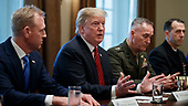 US President Donald J. Trump (C), with Acting Secretary of Defense Patrick Shanahan (L) and Chairman of the Joint Chiefs of Staff General Joseph Dunford (R), delivers remarks during a briefing by senior military leaders in the Cabinet Room of the White House in Washington, DC, USA, 03 April 2019. Following the briefing President Trump will host a dinner for the officials.<br /> Credit: Shawn Thew / Pool via CNP
