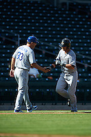 Glendale Desert Dogs third baseman Nicky Delmonico (23) shakes hands with manager Bill Haselman (33) after hitting a home run during an Arizona Fall League game against the Mesa Solar Sox on October 14, 2015 at Sloan Park in Mesa, Arizona.  Glendale defeated Mesa 7-6.  (Mike Janes/Four Seam Images)