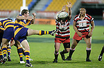Grant Henson charges down Jamie Nutbrowns clearing kick. Counties Manukau Steelers vs Bay of Plenty Steamers warm up game played at Mt Smart Stadium on 14th of July 2006. Counties Manukau won 25 - 20.