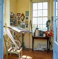 A draftsman's table in the gazebo that is used by designer Thomas Messel as a summer studio
