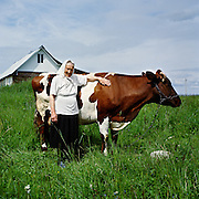 "Olga Ivanovna lives with her cow. There are just three cows in Izborsk now. Of course it is not easy to care for, but Olga Ivanovna is ok with it. Someone came up to her in the church the other day to ask ""Still giving yourself all that cow trouble?"". So she had to answer: ""Why trouble? I am fine with it, there's plenty of grass, thank God"".."