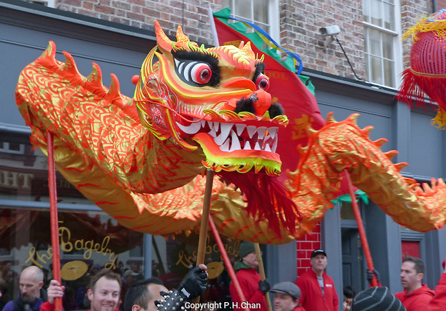 Thousands of people turned out in Liverpool's Chinatown to celebrate Chinese New Year on Sunday,  7th February. A long golden dragon paraded through Chinatown together with a lion dance. Firecrackers were set off to frighten away evil spirits. 2016 marks the start of the year of the monkey.