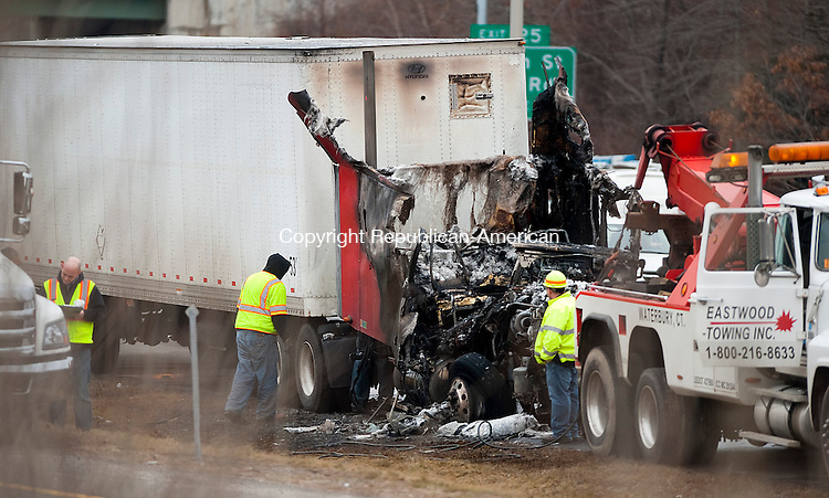 WATERBURY, CT-011614JS03- Officials were on the scene of a tractor-trailer fire on eastbound I-84 at Exit 25A in Waterbury on Thursday afternoon. Traffic was backed up for most of the afternoon.<br /> Jim Shannon Republican-American