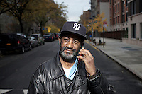 Mr Sinclaire Waithe, an HICAP attendee portrayed outside of The Gen Chauncey M. Hooper Towers, that hosts the Harlem Internet Computer Access program taught by instructor Merle Bush in Harlem, Manhattan, NY, USA on November 15, 2011.