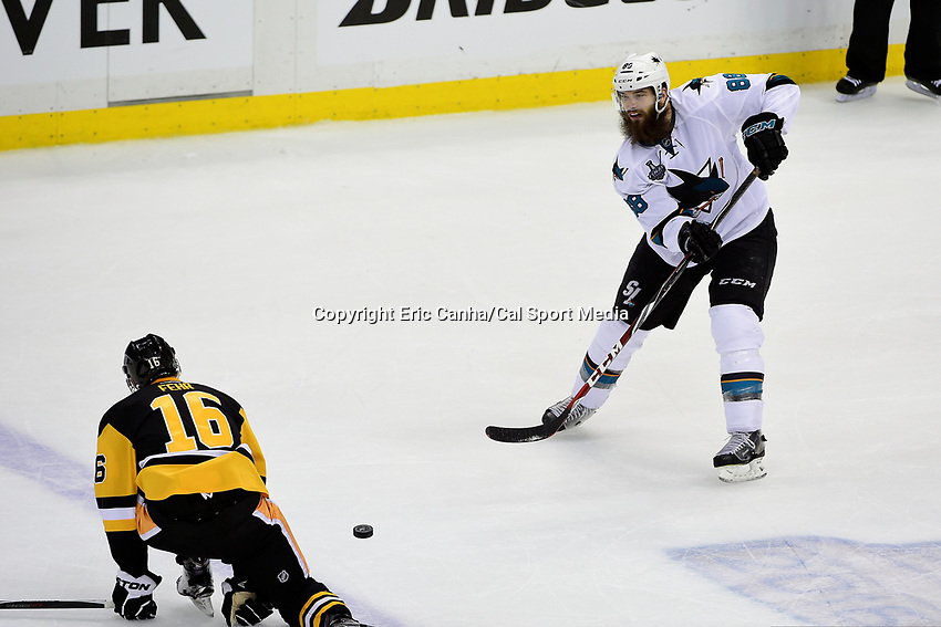 Monday, May 30, 2016: Pittsburgh Penguins right wing Eric Fehr (16) uses his body to try to stop a pass from San Jose Sharks defenseman Brent Burns (88) during game 1 of the NHL Stanley Cup Finals  between the San Jose Sharks and the Pittsburgh Penguins held at the CONSOL Energy Center in Pittsburgh Pennsylvania. The Penguins defeat the Sharks 3-2 in regulation time. Eric Canha/CSM