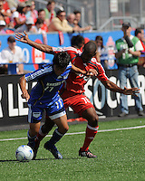 Marvell Wynne (16) and Kurt Morsink (11) battle for the ball. Toronto FC 0, Kansas City Wizards 0, BMO Field, Toronto, June 21, 2008.