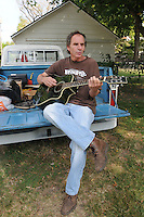 NWA Democrat-Gazette/FLIP PUTTHOFF <br /> BREAK-TIME SONG<br /> Matt James of Rogers sings and plays during a break from his job doing maintenance Tuesdsay Sept. 22 2015 on a home near Third and Locust streets in Rogers. James writes his own tunes and sang an original song from the tailgate of his 1971 Chevrolet pickup.