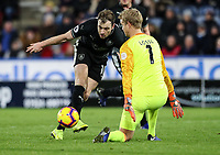 Burnley's Ashley Barnes competing with Huddersfield Town's goalkeeper Jonas Lossl<br /> <br /> Photographer Andrew Kearns/CameraSport<br /> <br /> The Premier League - Huddersfield Town v Burnley - Wednesday 2nd January 2019 - John Smith's Stadium - Huddersfield<br /> <br /> World Copyright © 2019 CameraSport. All rights reserved. 43 Linden Ave. Countesthorpe. Leicester. England. LE8 5PG - Tel: +44 (0) 116 277 4147 - admin@camerasport.com - www.camerasport.com
